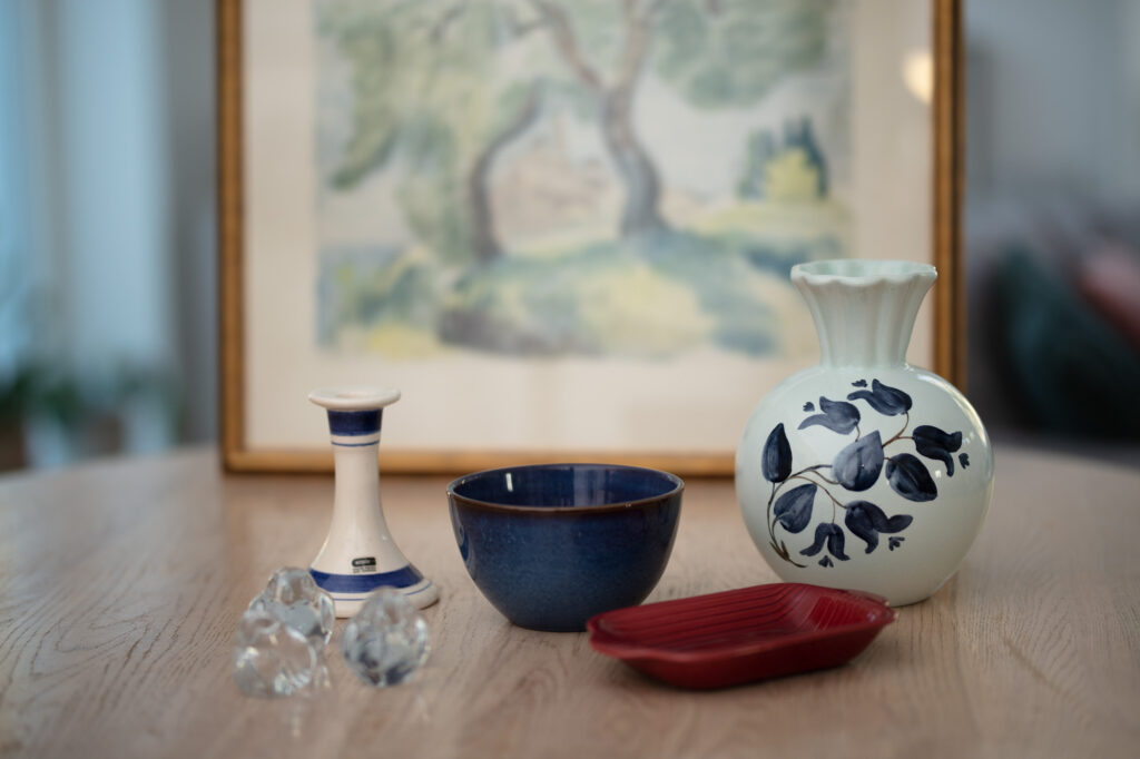 A candlestick, a bowl, a vase and some other flea market bargains.